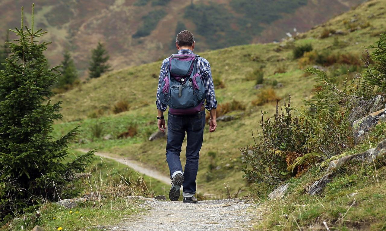 man backpacking