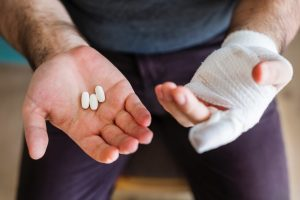 man with painkillers in hand