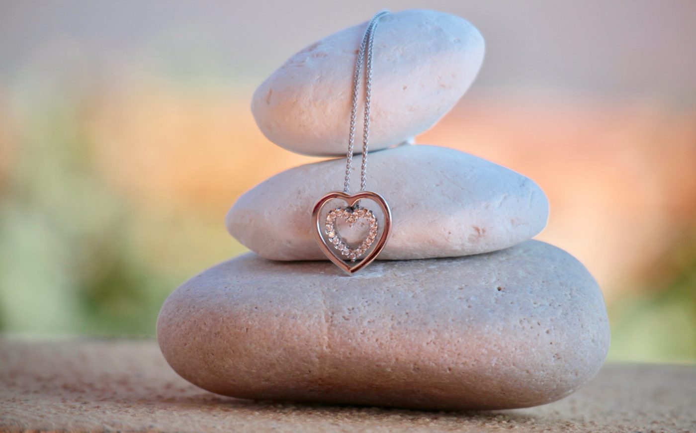 heart necklace over three stones